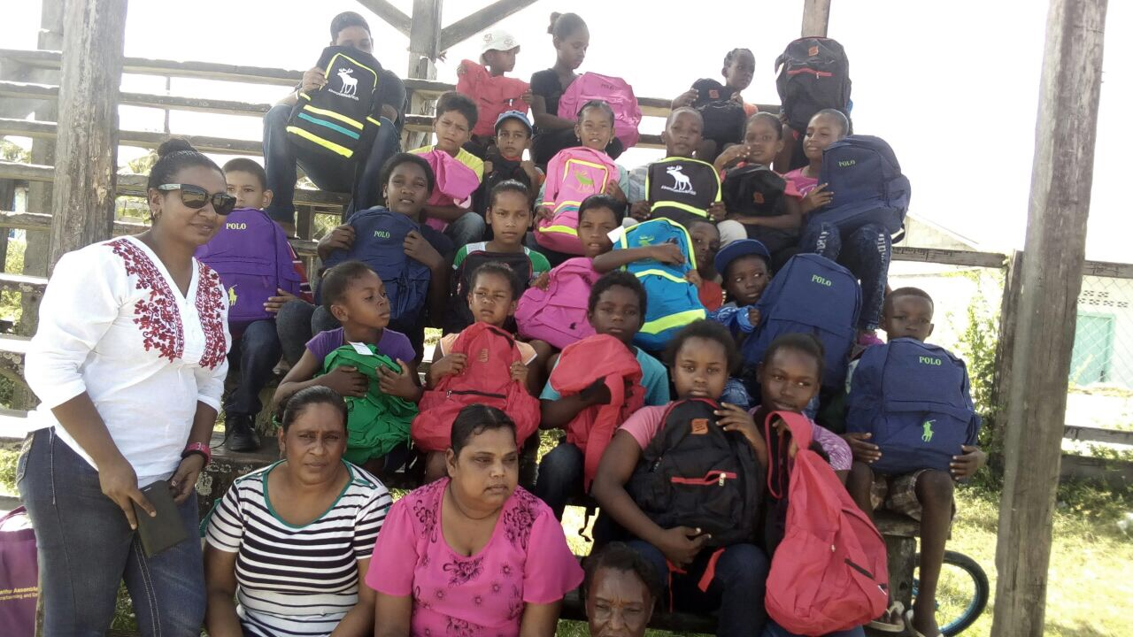 Dartmouth beneficiaries in company of Feona Suhkdeo, local organiser